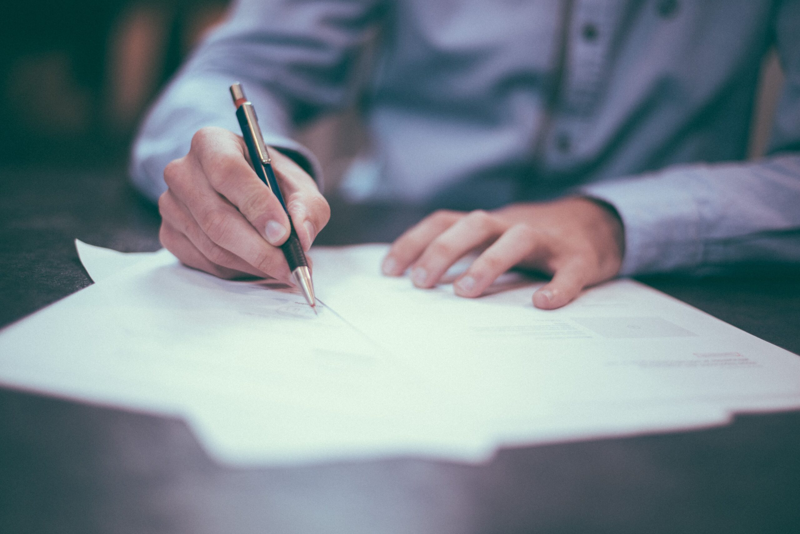 A man signing business document